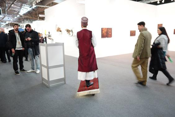 American-Iranian artist Darvish Fakhr scooting round the fair on Magic Carpet!